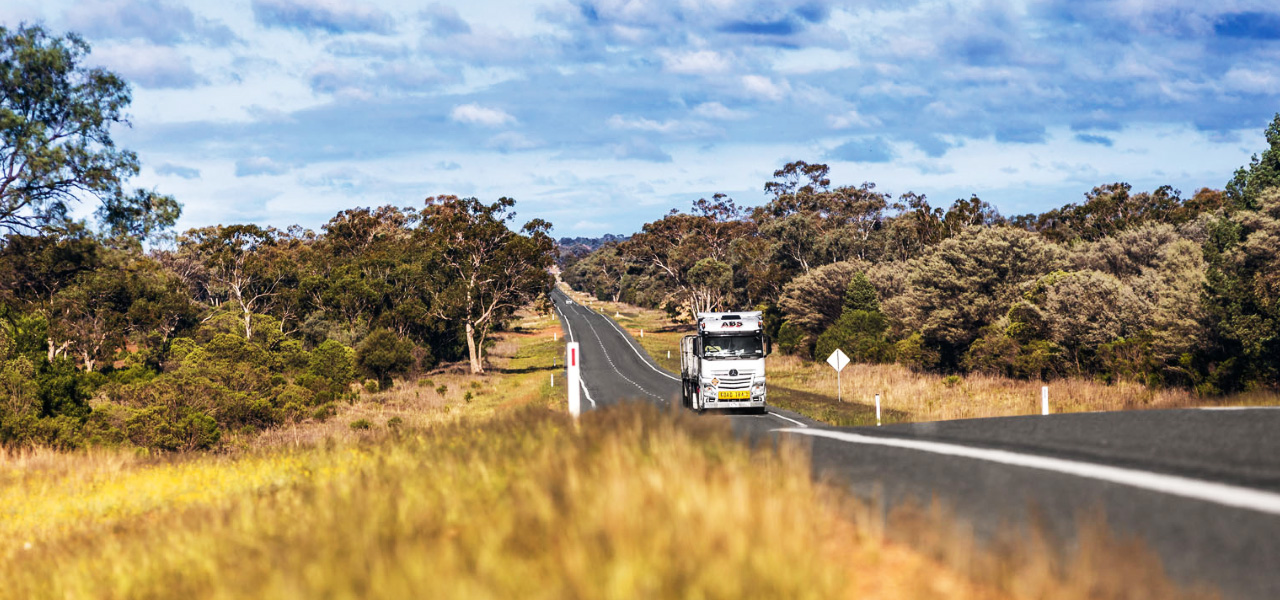 On the road for ABS Transport in the Outback with an Actros Road Train.